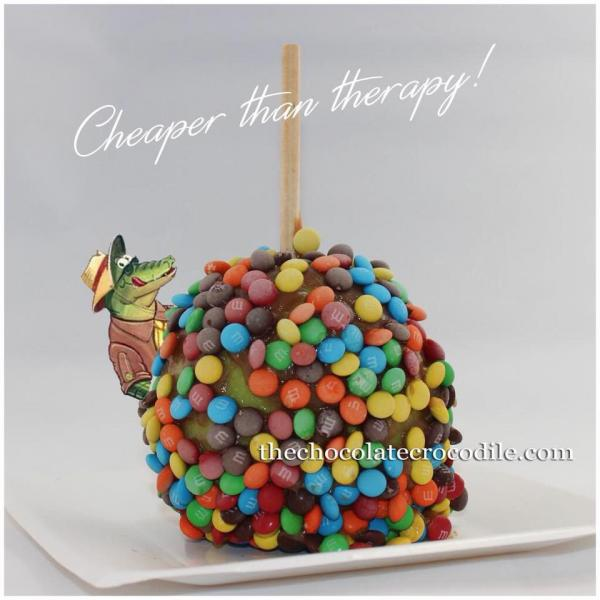 [Image: Take a bite of a chocolate dipped apple covered with M&Ms! mmmmm delicious! ]