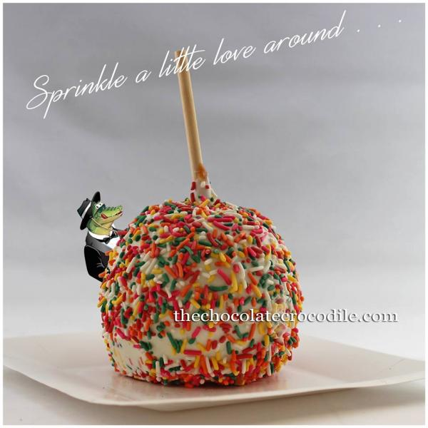 [Image: Satiate your sweet tooth with a sweet apple dipped in white chocolate and covered with sprinkles. ]